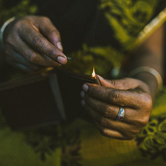 artisan hands crafting wallet